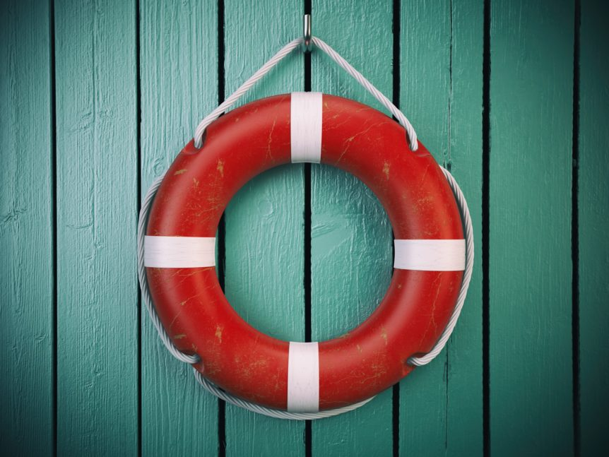 Life belt or rescue ring on wooden wall. Salvation, protection